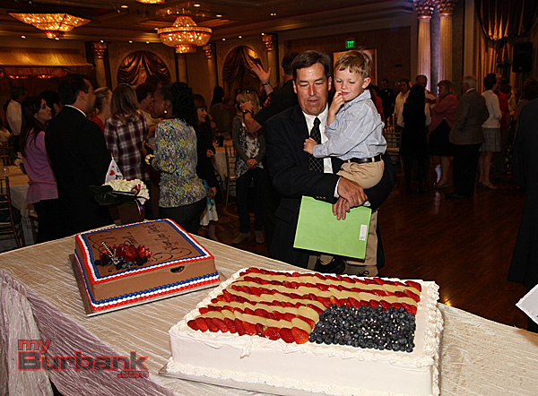 Dave Golonski with his grandson check out the yummy cakes during his thank you party.(Photo by Ross A. Benson)