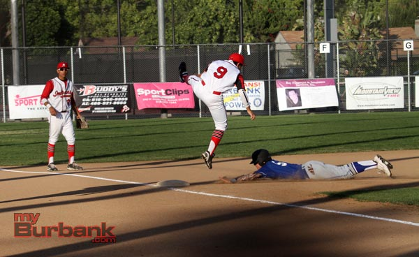 John White dives safely under the tag of Anthony Robles (Photo by Ross A. Benson)
