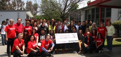 Students and Keller Williams Staff accept check for needed calculators. (Photo by Ross A. Benson)