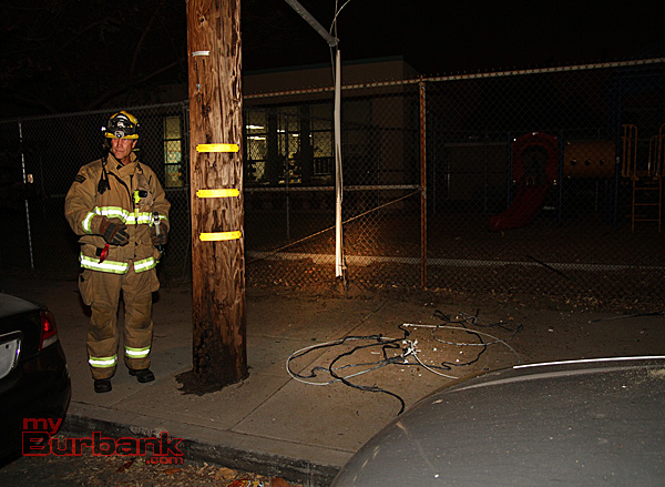 A Burbank Firefighter stands by with a electrical probe checking for electrical currency. (Photo by Ross A. Benson)