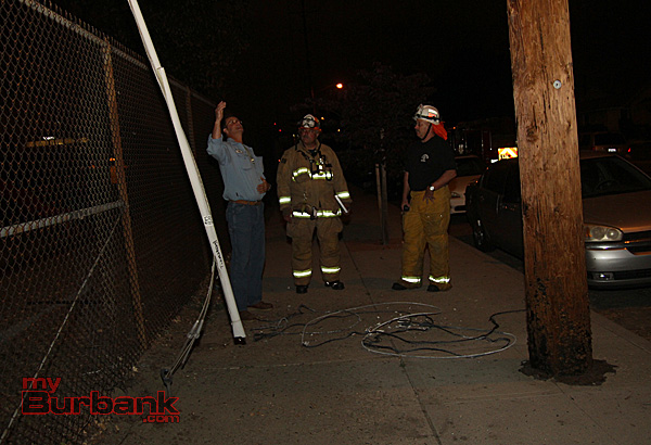 Electrical Services Supervisor Michael Gibson, explains to Capt. Jim Baldridge and Battalion Chief Jeff Howe what caused the electrical disruption. ( Photo by Ross A. Benson)