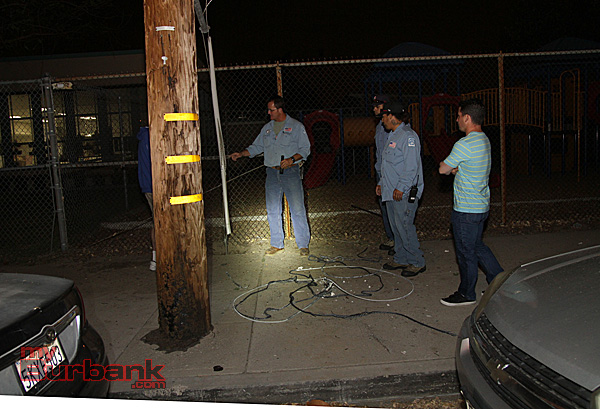 Electrical Services Supervisor Michael Gibson, talks  crews what caused the power disruption, prior to them repairing the situation. (Photo by Ross A. Benson)