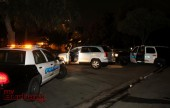Burbank Police wait for a tow truck so they can impound the suspects car in North Hollywood. (Photo by Ross A. Benson)
