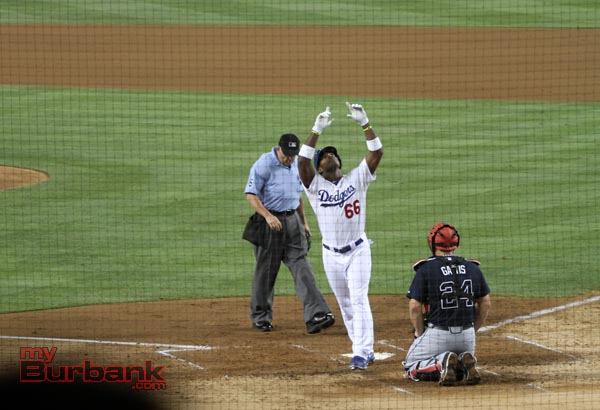 The Dodgers' Yasiel Puig after hitting a home run to tie the game at 1-1 (Photo by Ross A. Benson)