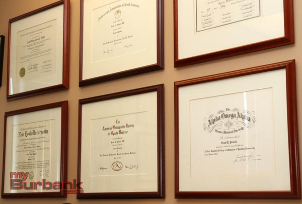 Dr. Powell's educational accomplishments (Photo by Ross A. Benson)