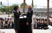 The oath of office is issued by LA District Attorney Jackie Lacy to Chief Scott LaChasse. (Photo by Ross A. Benson)