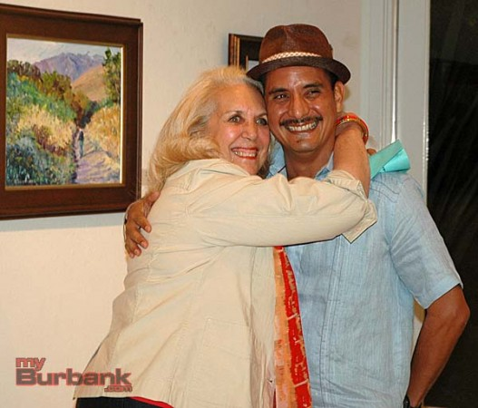 Best of Show winner Kaaren de Gorricho hugs exhibition chairman Ricardo Cerezo during the opening reception for the San Fernando Valley Art Club show on Friday night at the Burbank Creative Arts Center Gallery. (Photo by Joyce Rudolph)