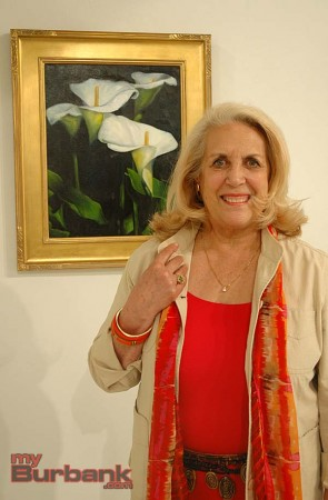 "Kaaren de Gorricho with her painting ""Lilies in My Garden"" which received the Best of Show and People's Choice awards   (Photo By Joyce Rudolph)"