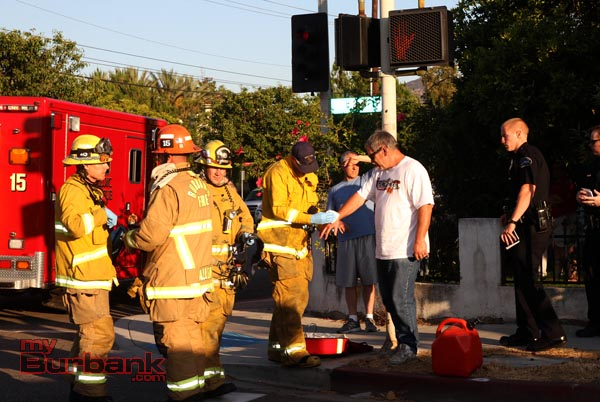 Burbank Firefighters treat the driver of a overturned van for a minor injury following this accident. (Photo by Ross A. Benson)