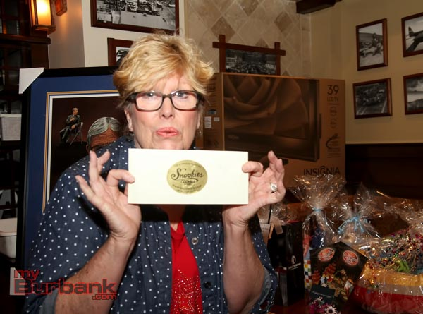 Historical Board Member Sue Baldaseroni holds a gift certificate to Snookies that was offered.(Photo by Ross A. Benson)