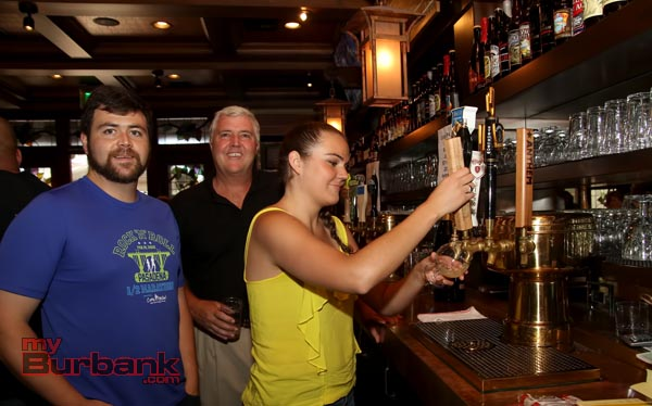 Story Tavern employees and owner L/R Brian Slaught, Center Ted Slaught, and right Diane Slaught working the tap. (Photo by Ross A. Benson)