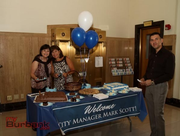 City Hall Staffers prepared refreshments and fresh baked goods for the reception of new city Manager Mark Scott. (Photo by Ross A. Benson)