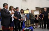 Center Christopher Nardo and Sister Angala unveil new plaque with additional family members. (Photo by Ross A. Benson)