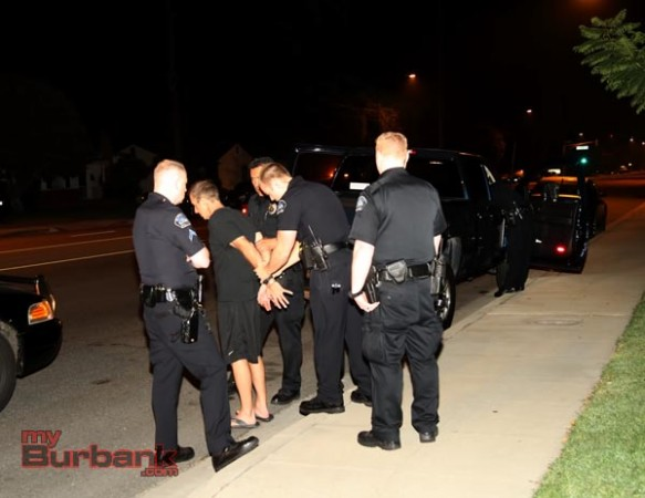 Detained for DUI and placed in handcuffs, this suspected DUI driver struck the rear of a Burbank Patrol Car and then failed to stop when requested.( Photo by Ross A. Benson)