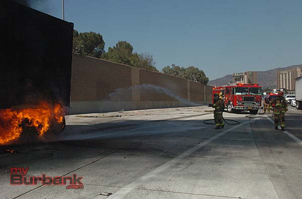 Burbank firefighters work to put out a big rig fire on the I-5 freeway (Photo By Nick Colbert)