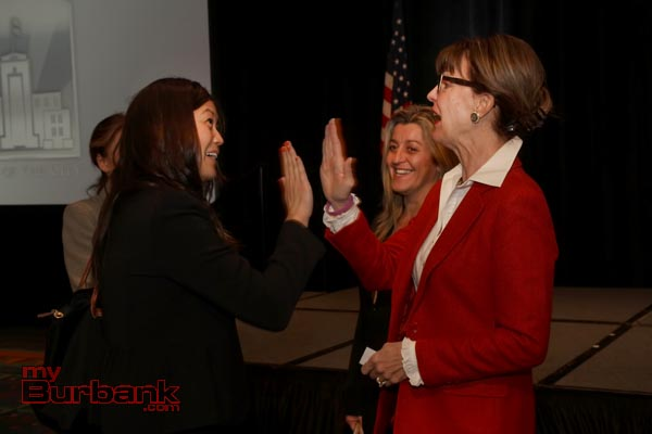Mayor Emily Gabel-Luddy gets a high-5 from Planning Board Member Kimberley Jo a former City Council Candidate herself. (Photo by Ross A. Benson)