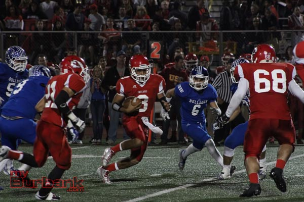 Burroughs' Andrew Williams threw for 174 yards and rushed for another 50 (Photo by Ross A. Benson)