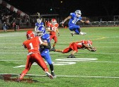 James Williams clears a Burroughs defender en route to a 38-yard touchdown run (Photo by Craig Sherwood)