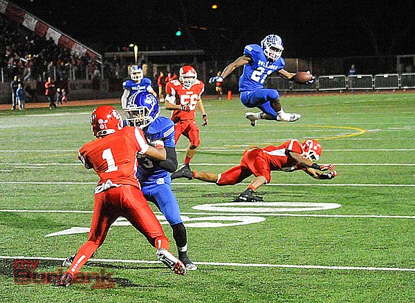 Williams clears a Burroughs defender en route to a 38-yard touchdown run (Photo by Craig Sherwood)