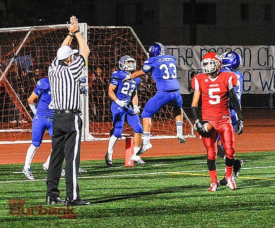 Burbank celebrates a safety that gave the Bulldogs a 33-14 lead (Photo by Craig Sherwood)
