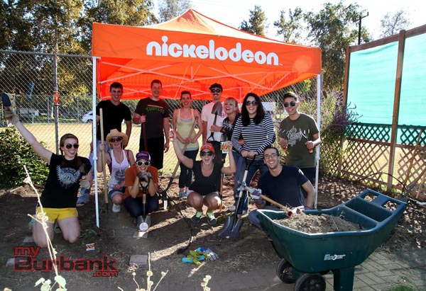 Nickterns spent the day cleaning out and re-planting Disney Elementary's school garden. (Photo By Ross A. Benson)