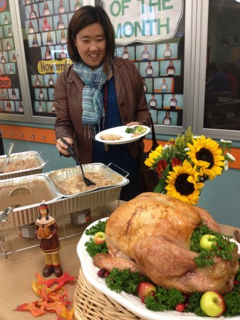 Science teacher Heidi Sasaki checks out the huge turkey. (Photo Courtesy of John Muir Middle School)