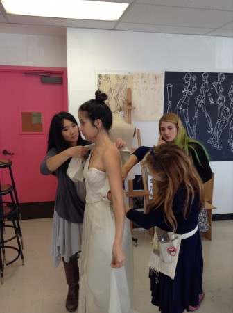 Soloist Danielle Belen is fitted in her gown, designed by Woodbury University fashion design program seniors. (Photo Courtesy of Burbank Philharmonic)