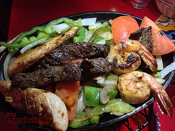 Tops In Town Fajitas Combo sizzles on the hot plate. (Photo By Lisa Paredes)