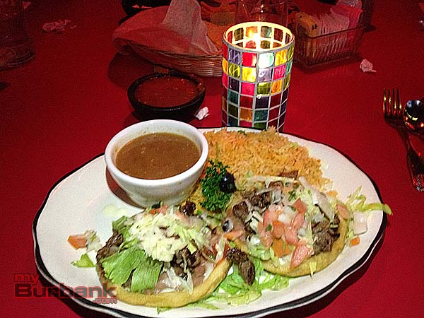 Carne Asada Sopes layer beans, meat, lettuce, cheese and sour cream on a thick corn tortilla. (Photo By Lisa Paredes)
