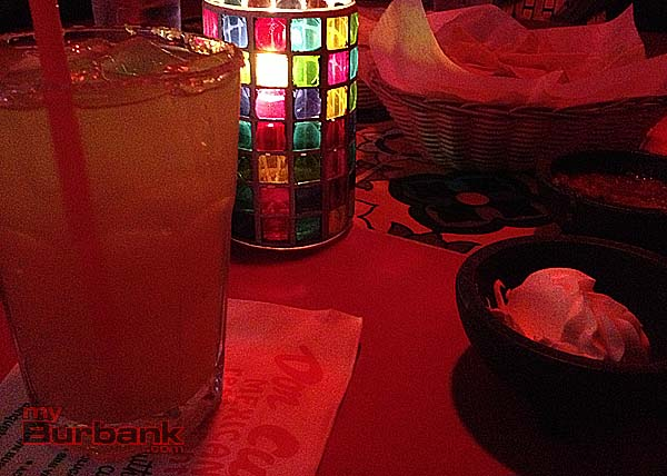 Chips, spicy salsa and cooling sour cream compliment a Cadillac Margarita. (Photo By Lisa Paredes)