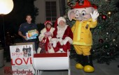 Joining Santa & Mrs Claus is Burbank Fire Fighter John Freeborn and Fire Mascot Lil Squirt, helping collecting toys for this years Spark of Love Toy Drive. (Photo by Ross A. Benson)