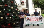 Burbank Firefighters L/R Engineer John Freeborn, Captain Mark Hatch, and Firefighter Clint Coe, prepare for this years 'Spark of Love Toy Drive'.  (Photo by Ross A. Benson)