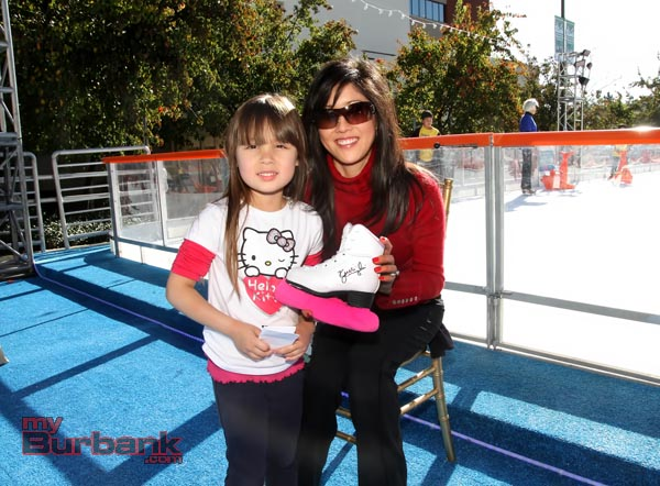 Olympian Kristi Yamaguchi poses after autographing this young skaters ice skates during her visit at  The Rink on Wednesday. (Photo by Ross A. Benson)