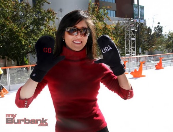 Olympian Kristi Yamaguchi poses with mittens that support USOC with funds that help future Olympians (Photo by Ross A. Benson)