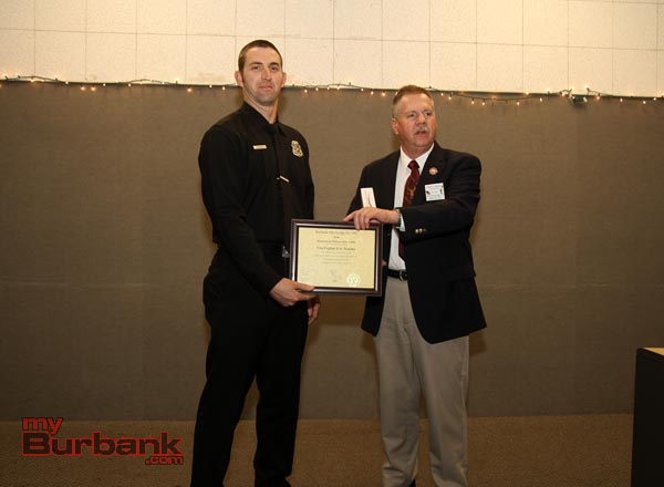 Firefighter of the Year Eric Rowley, with Exalted Ruler and former Burbank Fire Capt. Bob Ramsey. (Photo by Ross A. Benson)