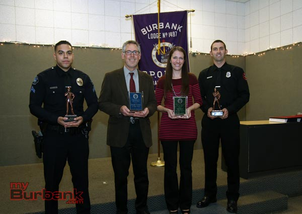 Elk's Community Service Award recipients BPD Officer Christian Diaz, City Employee Kreigh Hampel, Teacher of the Year Jill Tobin, and Fire Fighter of the yr Eric Rowley. ( Photo by Ross A. Benson)