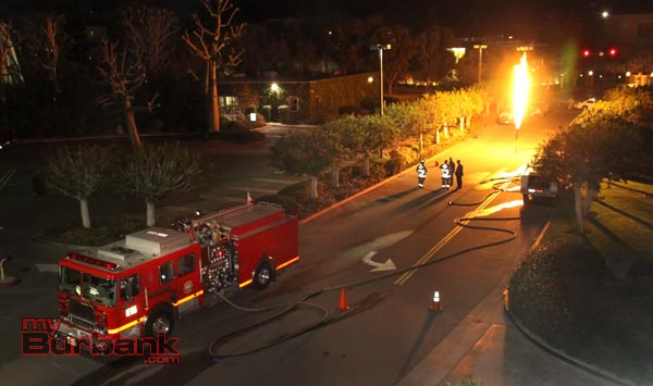Burbank Firefighters stand by as propane is burned off following a day long Hazmat situation at Saint Joseph Medical Center. ( Photo by Ross A. Benson)