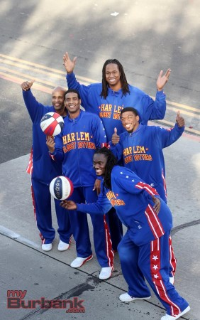 The Harlem Globetrotters take a quick pose while spinning and preforming. ( Photo by Ross A. Benson)