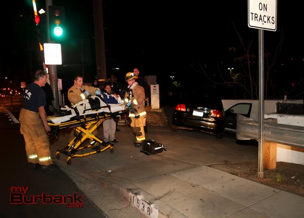 Burbank Fire Firefighters & Paramedics render aid to the driver that missed the turn at Vanowen St. &  Buena Vista Street. (Photo by Ross A. Benson)