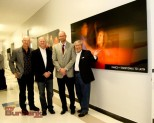 Attending the art unveiling are, from left to right, photographer Rob Outwater, David Luckenbill, Coloredge Senior Account Executive, Principal Joseph Stark and Bob Matsumoto, Creative Director. ( Photo by Ross A. Benson)