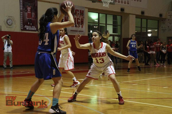 Burroughs' Alondra Ramirez applies pressure to Fatima Cisneros of Burbank (Photo by Ross A. Benson)