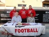 Hawkins Mann, left, and Sean Johnson are joined by Burroughs coach Keith Knoop, defensive coordinator Kenny Knoop and (Photo by Ross A. Benson)