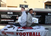 Hawkins Mann and Sean Johnson show off their signed letters of intent (Photo by Ross A. Benson)
