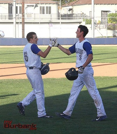 Cameron Briggs (rt) is congratulated by Conner Lockheimer after Briggs' game winning hit (Photo by Dick Dornan)
