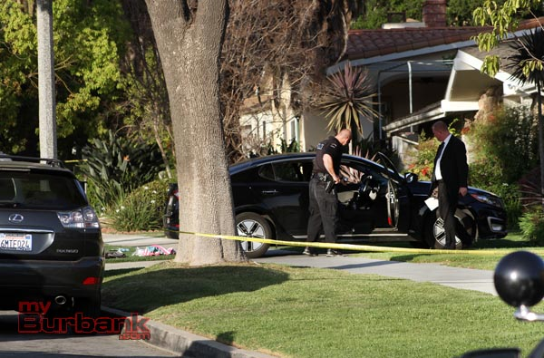 Burbank Police Officers and Detectives look at the car where 2 males drove in after being stabbed on Sunset Cyn & Orange Grove Ave in the parking lot of The Church of Later Day Saints. The two drove to the 1100 Blk of Angeleno Avenue were police & paramedics were called to help. ( Photo by Ross A. Benson)