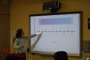 A student selects an answer on the SMART Board. (Photo By Lisa Paredes)