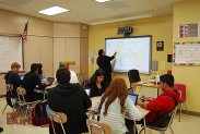 Teacher Debbie McHorney uses the SMART Board in class. (Photo By Lisa Paredes)