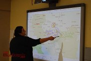 Teacher Debbie McHorney interacts with the SMART Board. (Photo By Lisa Paredes)