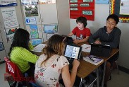 Students take a quiz on the iPads. (Photo By Lisa Paredes)