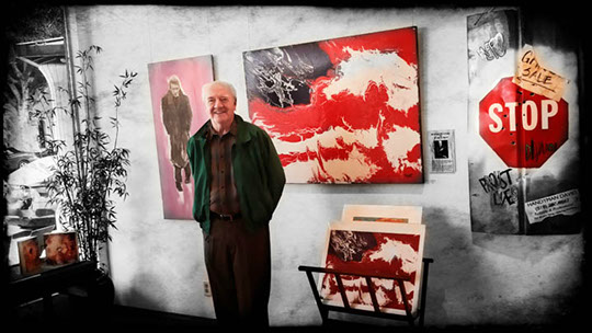 Richard Herd with some of his art. (Photo Courtesy of Towns Burr Gallery)